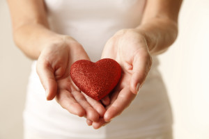 Give love -giving, charity, heart in hand