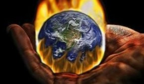 Hand holding earth on fire
