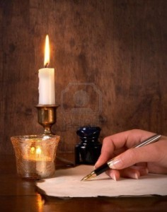 Hand-writing-on-parchment-with-a-golden-pen