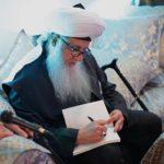 Mawlana Shaykh Nurjan Signing Book Qalam Change Destiny