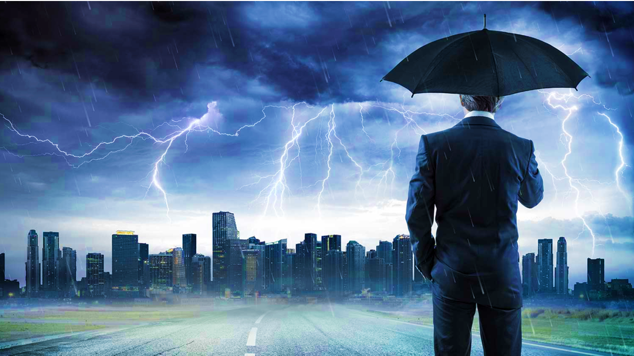 Person standing in storm over city
