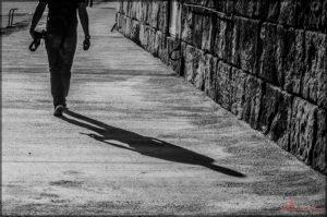 Shadow of man behind him