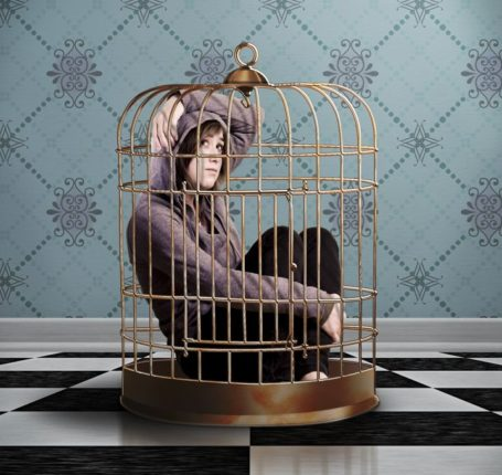 Woman in a cage