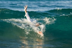 Businessman Drowning in Ocean --- Image by © Mark A. Johnson/Corbis