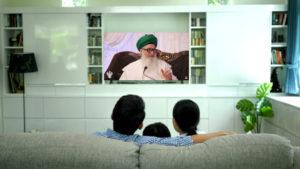 family watching live zikr, Shaykh Nurjan on Tv