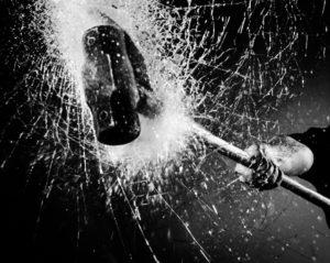 hammer smashing glass destroying property violence