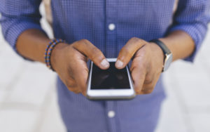 man-hands-texting-thumb