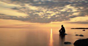 man-silhouette-contemplation-muraqabah-rock-ocean-sunlight