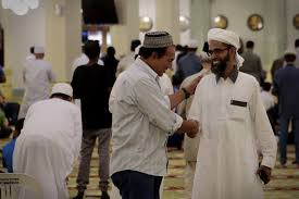 men-greet-each-other-mosque