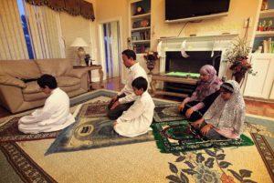 muslim family praying together at home. salah, namaz