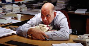 person hoarding money