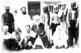 Shaykh Abdullah ad-Dagehestani with murids in Damascus. Shaykh Nazim is to the right of Grandshaykh and Shaykh Hussein is to his left.
