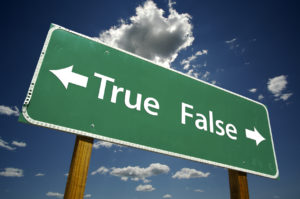 True, False road sign with dramatic blue