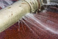water-leaking-hole-hose-garden-67880771