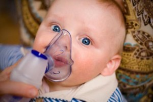 young blue eyed child with asthma